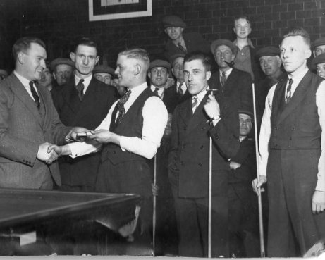 Richard hand's out prizes in billiard and snooker hall South Shields.